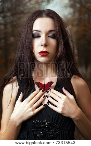 Lovely Young Girl With Closed Eyes Holds Red Butterfly In Hands
