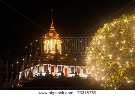 Night View Of Wat Rat Natda Ram Worawihan Monastery.
