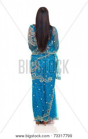 back view of indian woman in saree isolated on white background