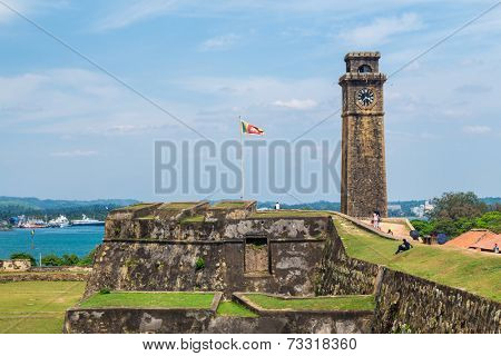 GALLE, SRI LANKA - MARCH 9, 2014: Clock tower in Galle fort.  Fort was originally built in 1684 to house the Dutch Governor and his staff and today is UNESCO World Heritage Site