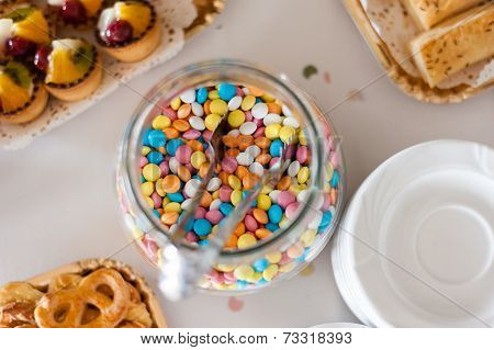 Multicolor bonbon sweets in a jar