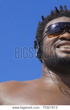 African man listening to headphones