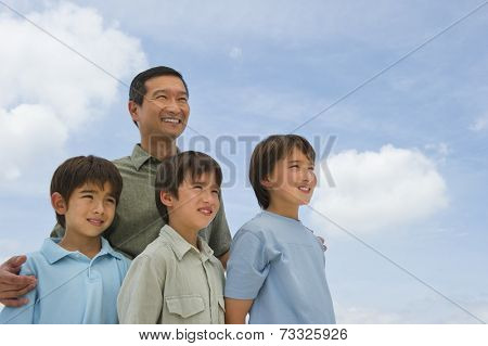 Smiling father and sons