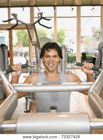 Pacific Islander man exercising in health club