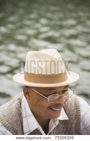 High angle view of senior African man smiling outdoors