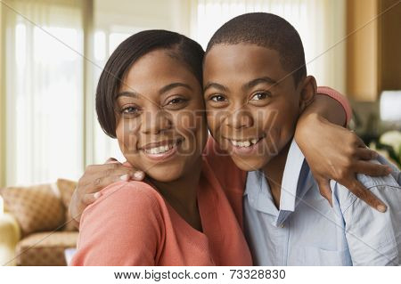 African mother hugging son