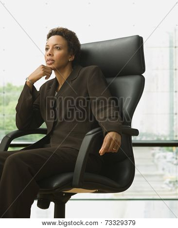 African American businesswoman sitting in chair