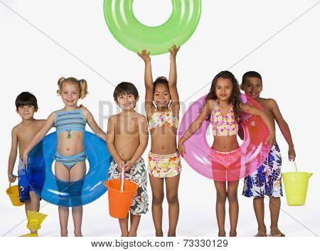 Multi-ethnic children wearing bathing suits
