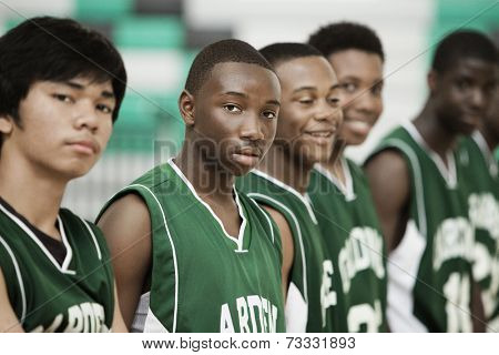 Basketball players standing in row