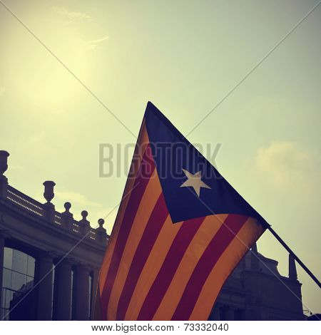the estelada, the Catalan pro-independence flag, against the sky with a retro effect