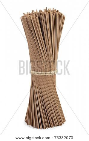 dried soba noodles on a white background
