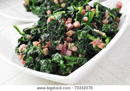 closeup of a bowl with spanish espinacas con jamon, spinach with ham