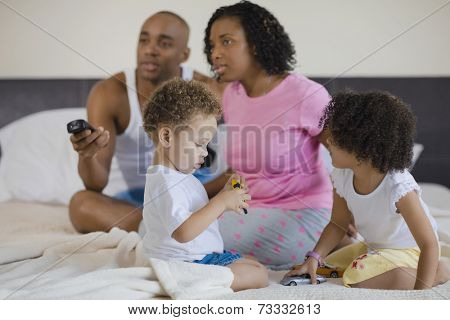 African family watching television and playing