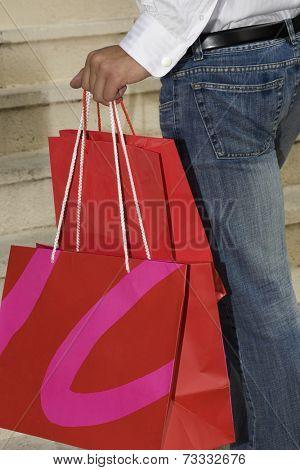 Hispanic woman holding shopping bags