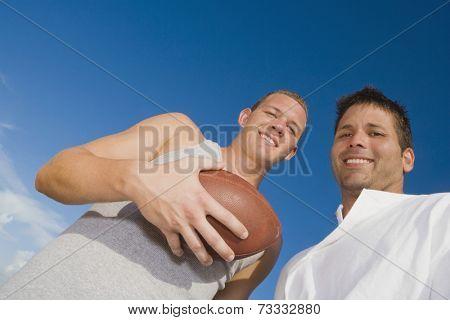 Multi-ethnic men with football