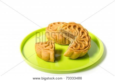 Chinese Mooncake And Cutout Over White Background