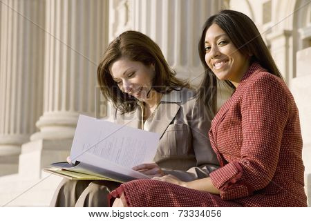 Multi-ethnic businesswomen looking at paperwork
