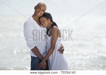 Multi-ethnic couple hugging at beach