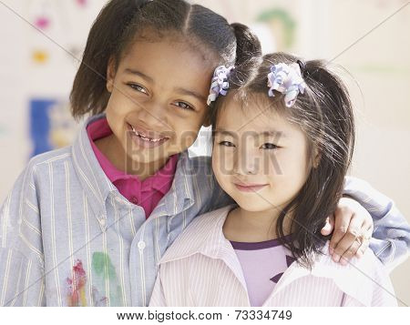 Multi-ethnic girls hugging