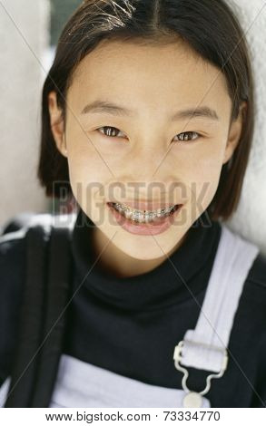 Asian girl with orthodontic braces