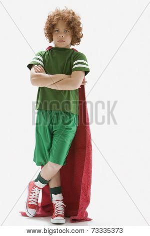 Mixed Race boy wearing towel as cape