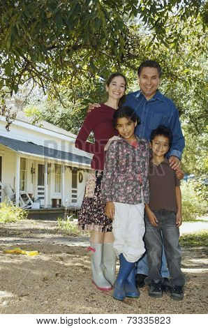 Multi-ethnic family in front of house