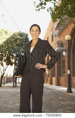 Asian businesswoman with hand on hip