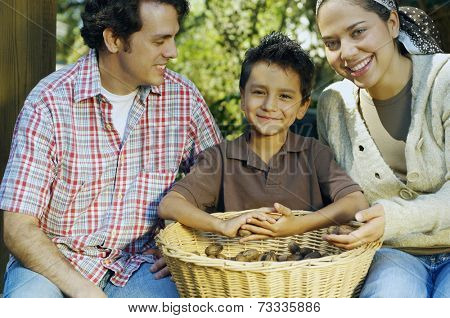 Multi-ethnic family with basket of organic produce