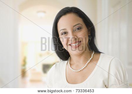 Hispanic woman wearing pearl necklace