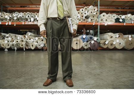 African male sales clerk in flooring warehouse