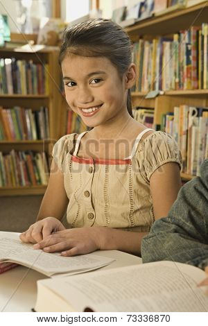 Pacific Islander girl in library