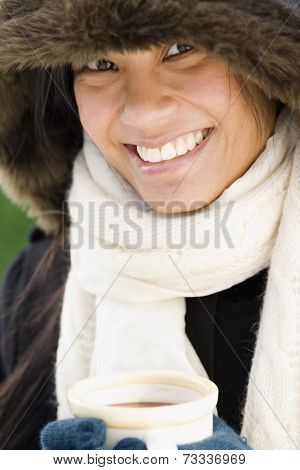 Pacific Islander woman drinking hot chocolate