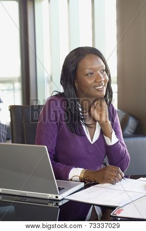 African businesswoman working at home