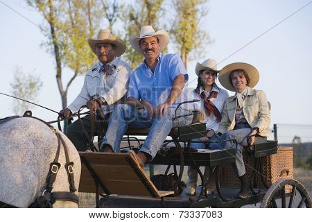 Hispanic family in horse-drawn carriage