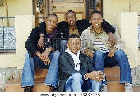 African men sitting on porch steps