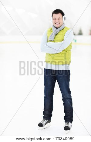 A picture of a happy man on the ice rink