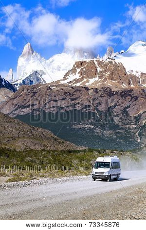 Touristic Car On Road In Fitz Roy Mountain Range, Los Glaciares National Park, Argentina.