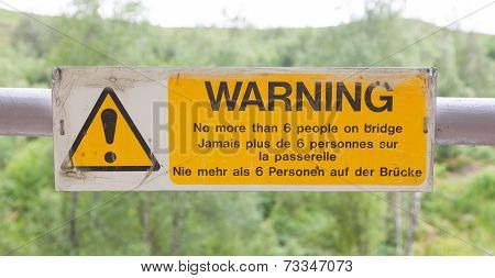 Warning Sign At A Bridge