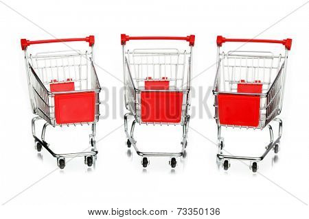 three empty shopping carts, isolated on white