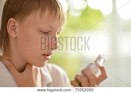 Teenage boy with inhaler
