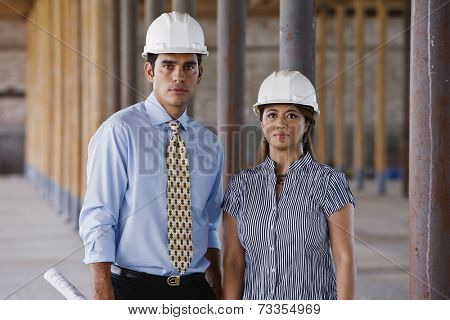 Multi-ethnic businesspeople wearing hard hats