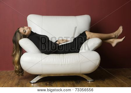 Middle Eastern woman laying on chair