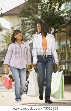 African teenaged girls carrying shopping bags