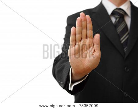 Businessman Showing Stop Sign On Neutral Background