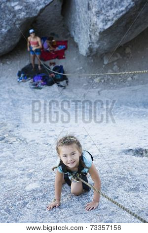 Asian girl rock climbing