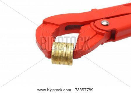 Salary Or Inomce Concept With Pipe Wrench And Coins