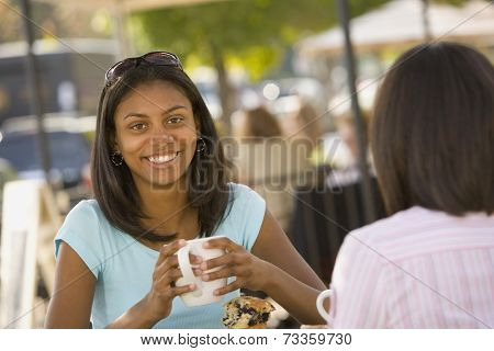 African teenaged girl holding coffee mug