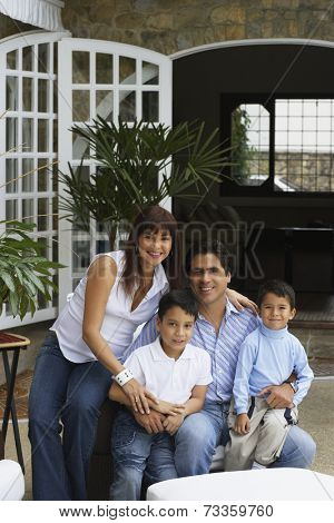 Hispanic family sitting on patio