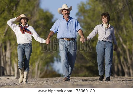 Hispanic family holding hands