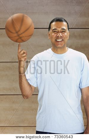 African man spinning basketball on finger